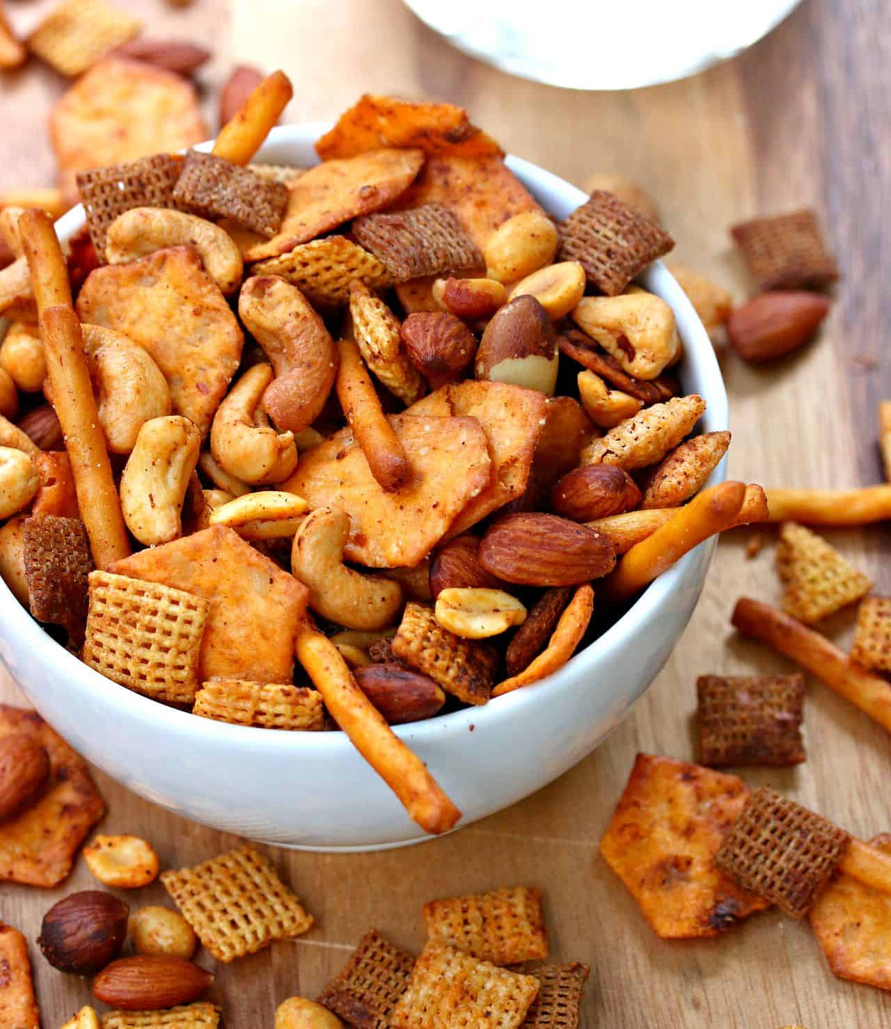 white bowl overflowing with chex mix